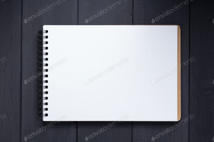 notepad at black wooden background surface table