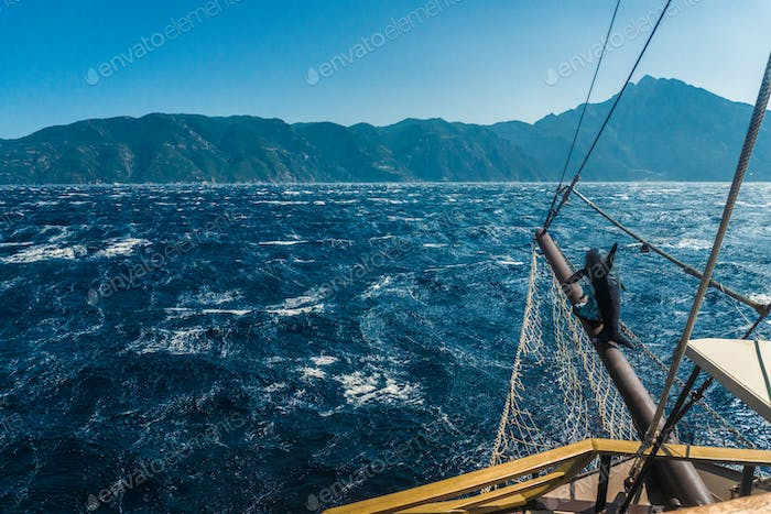 Waves on the sea and the mast of the ship in Greece