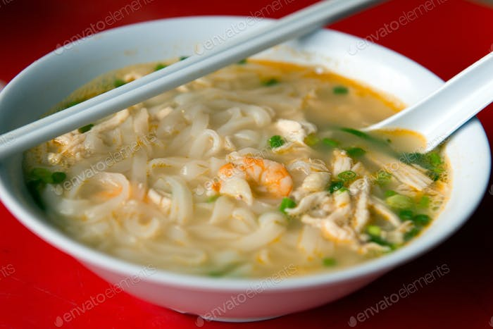 Rice noodle soup with shredded chicken