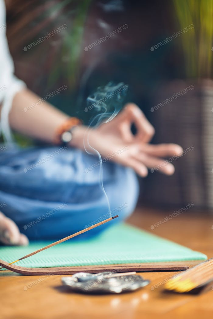 Meditation.  Woman Enjoying Incense Stick