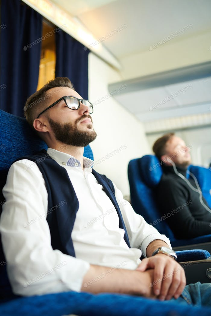 Young Man Sleeping in Plane