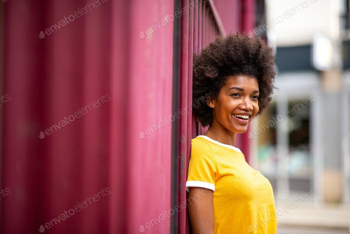 beautiful young African American woman smiling outside