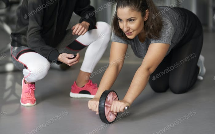 Close up of young woman exercising in the gym