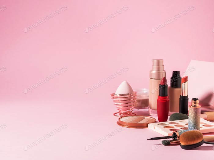 Cosmetics beauty products background with on pink