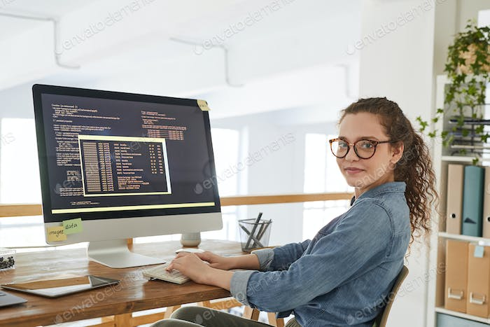 Young Woman Writing Code in Office