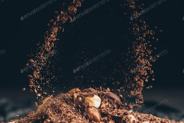 Falling shredded chocolate pieces on a chocolate pile