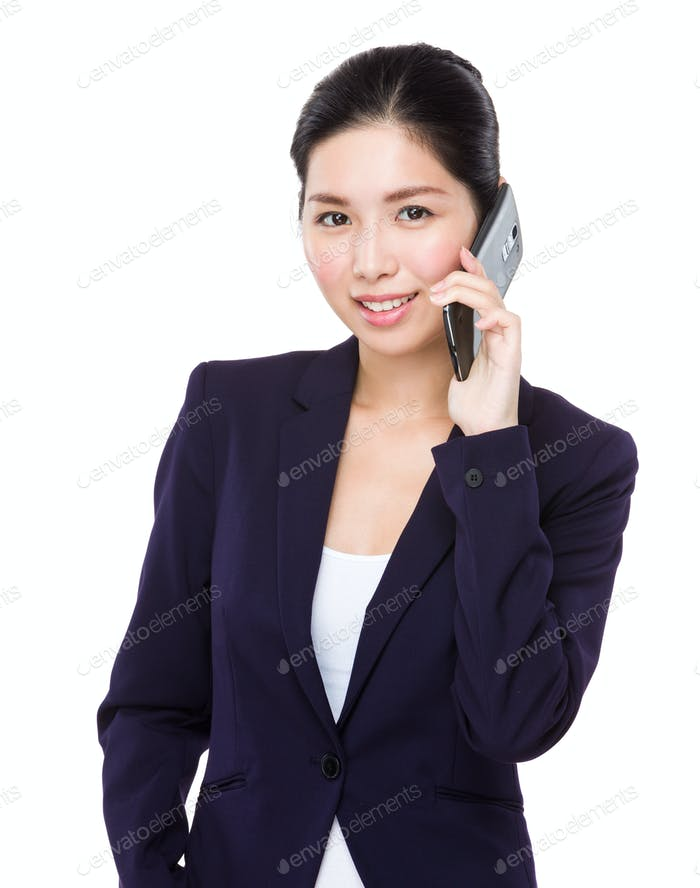 Businesswoman talk to mobile phone