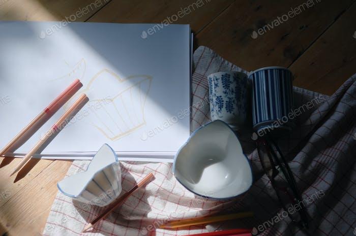 The ceramic artist has designed on paper