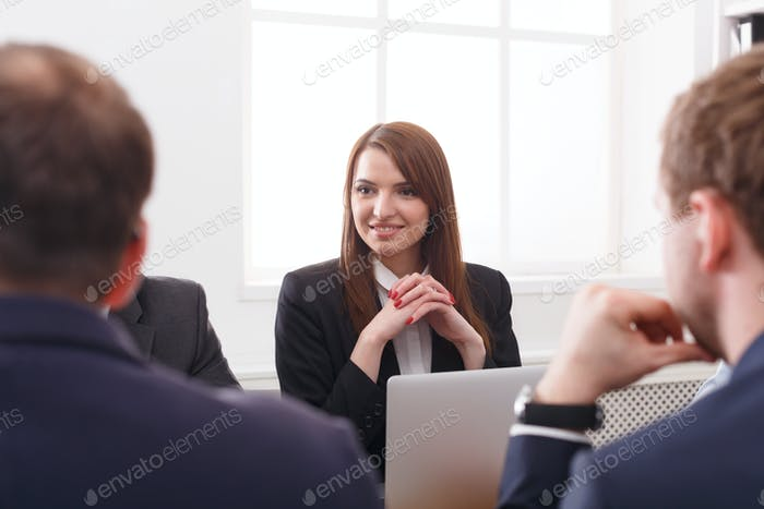 Business meeting. Portrait of young successful woman