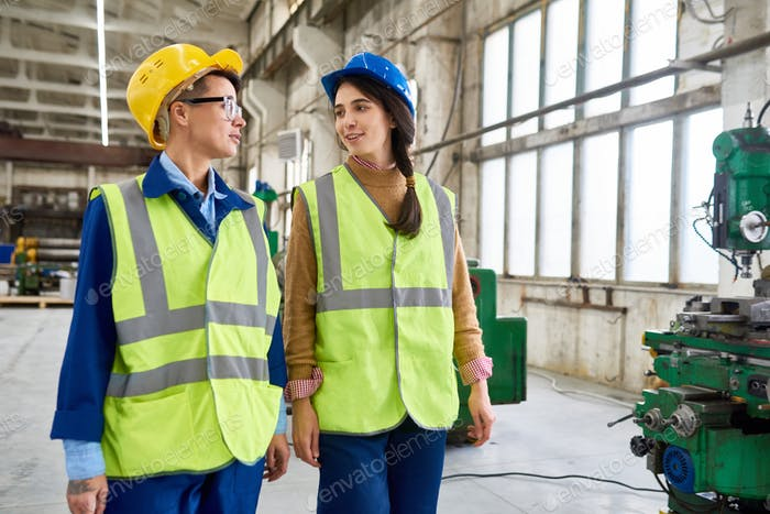 Two Female Workers at Modern Plant