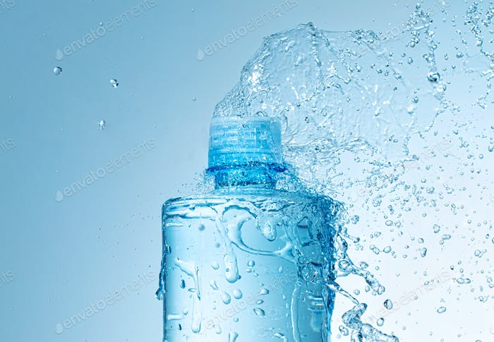 close up of water bottle with splashes