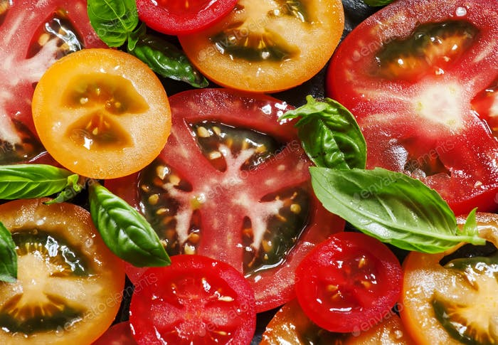 Ingredients for the salad of colorful tomatoes and basil