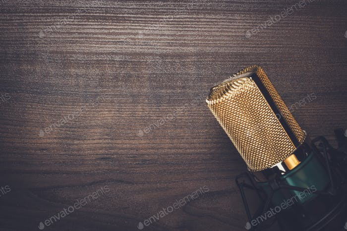 vintage condensing microphone on the wooden background