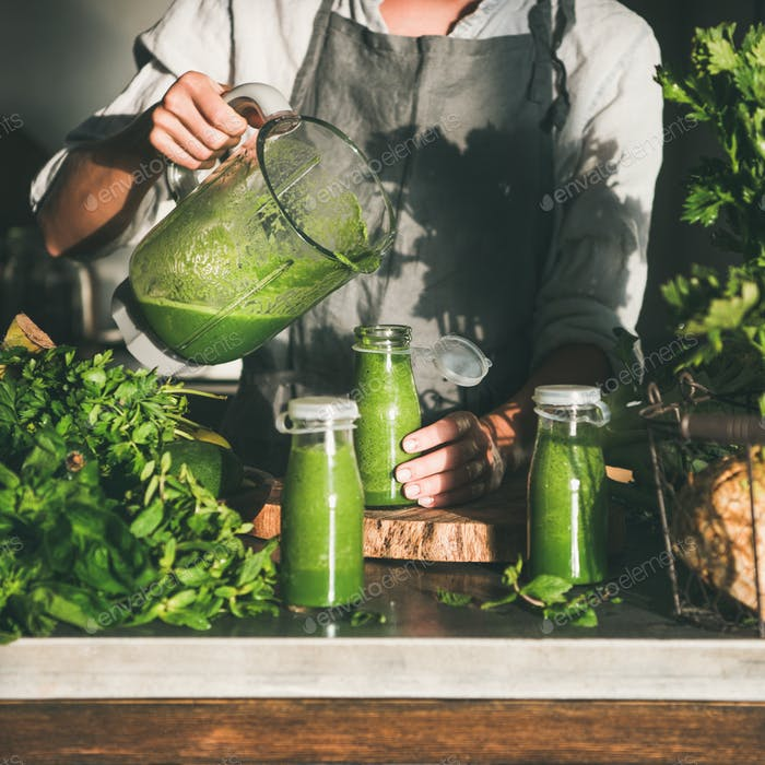 Woman pouring green smoothie from blender to bottle, square crop