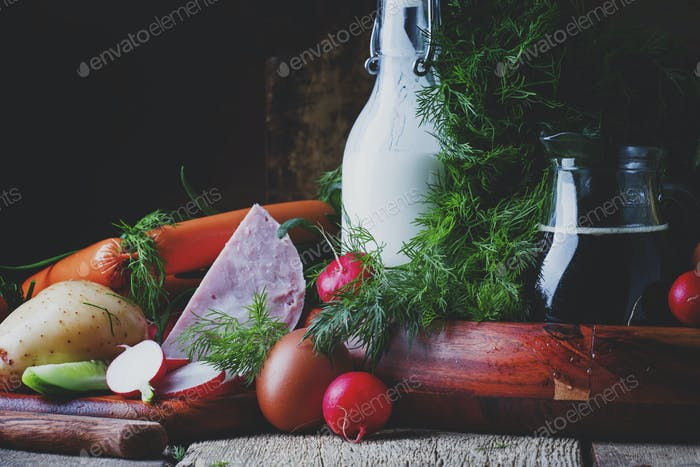 Ingredients for cold soup with vegetables, herbs and meat products