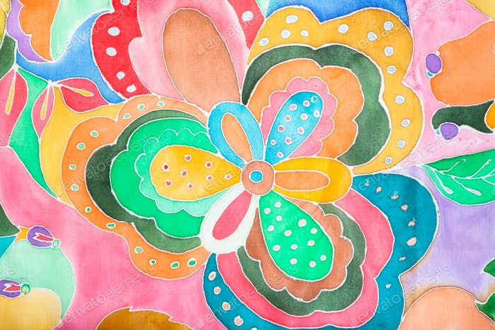 detail of floral pattern hand-drawn on silk scarf