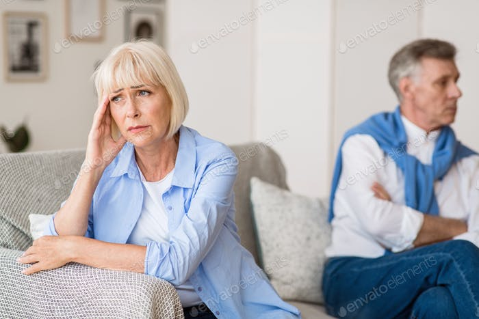 Sad senior woman after arguing with husband