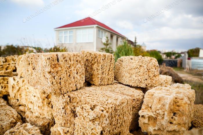 Limestone bricks heap for building a house