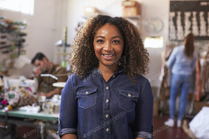 Mixed race female business owner in clothing design studio