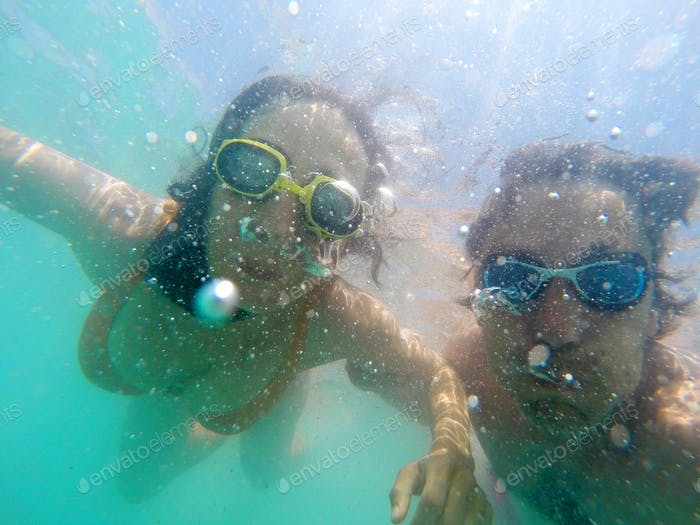Couple having fun underwater in the sea