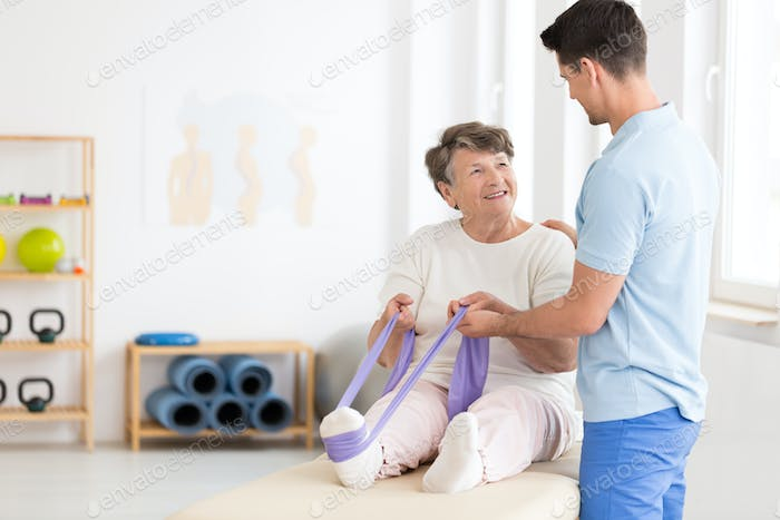 Elderly woman exercising with band