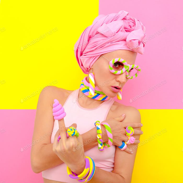 Candy fashion girl in sweet accessories. Candy minimal style