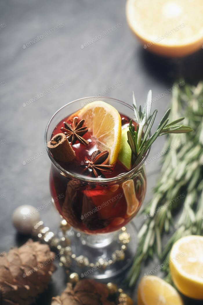 Mulled wine with different spices vertical