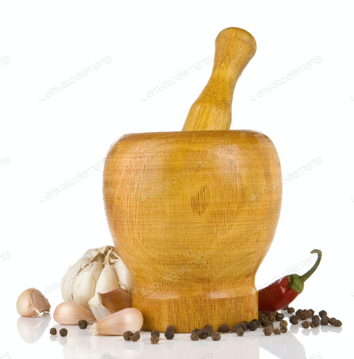 garlic, pepper in mortar and pestle on white