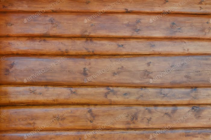 The texture of the wall of the house is made of round logs, covered with protective impregnation.