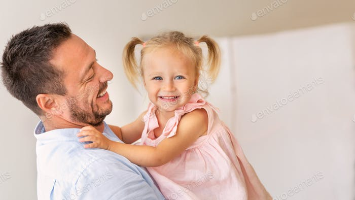 Loving father with daughter looking at camera