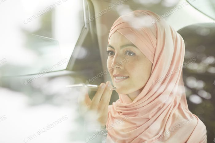 Muslim businesswoman in car