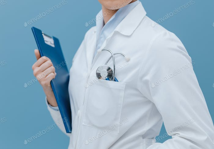 Professional female doctor posing with a clipboard
