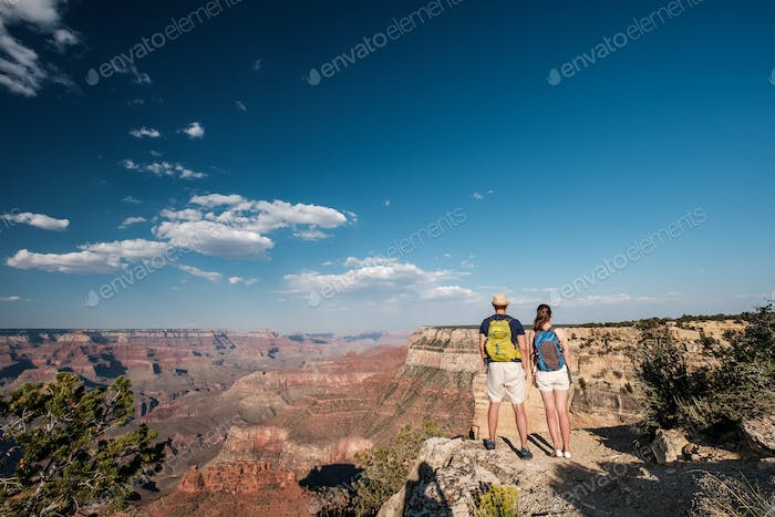 Tourists with backpack hiking at Grand Canyon