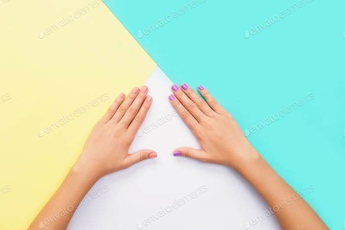 Bright manicure on diffrent backgrounds as triangle.