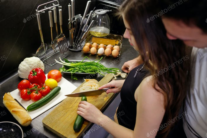 Paleo diet,vegan lifestyle couple share a healthy nutritional lunch snack