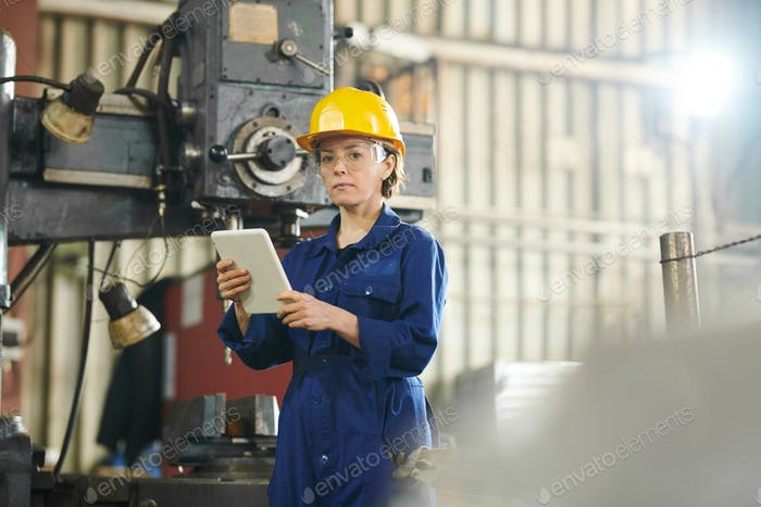 Female Worker Using Tablet at Factory