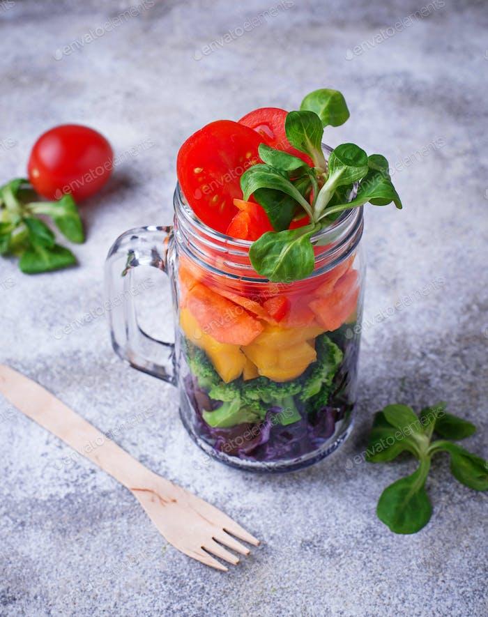 Vegetarian rainbow salad in a glass jar