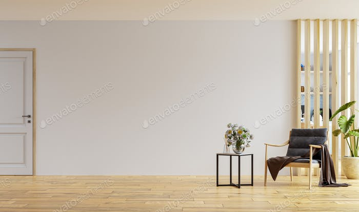 Armchair in modern apartment interior with empty wall.