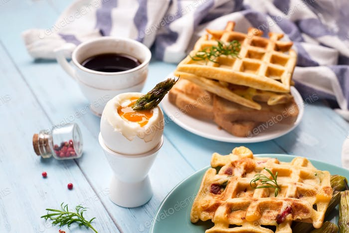 Breakfast with egg and a cup of coffee