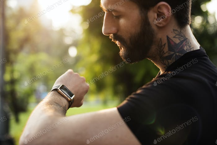 A man looking at his smartwatch