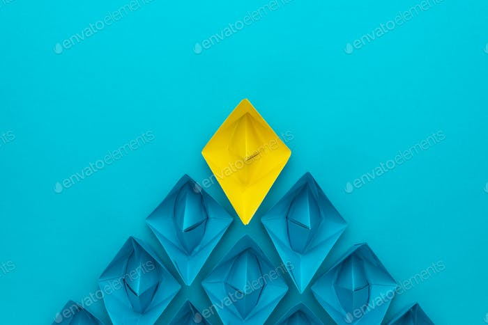 Yellow Paper Ship Ahead Of Blue Ones Leadership Concept