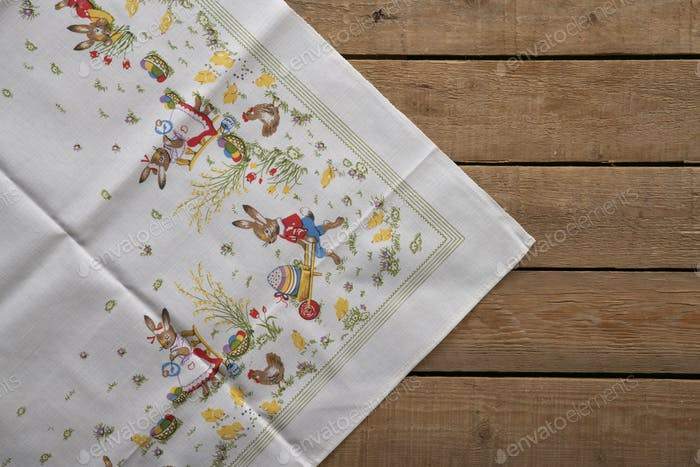 Easter tablecloth on a wooden old rustic table