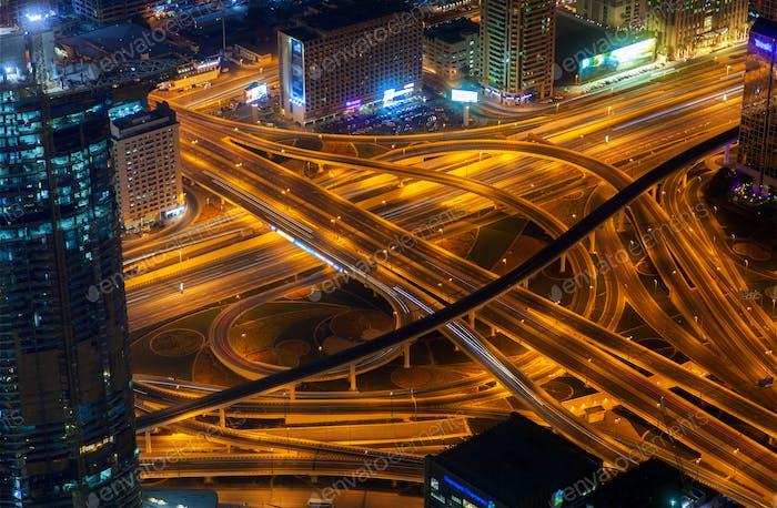 night dubai traffic junction aerial