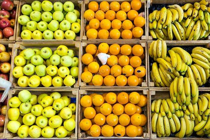 Different types of colorful fresh fruits in health grocery shop.