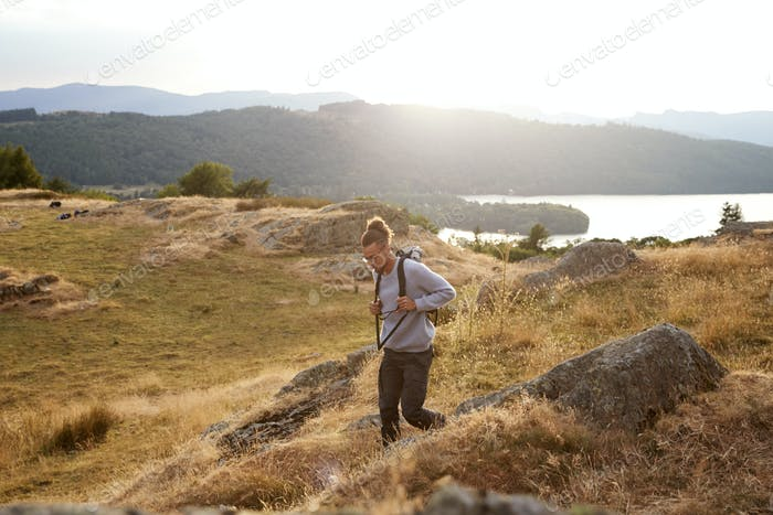 A young mixed race man walking alone in the mountains