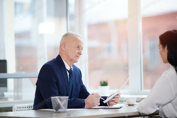 Senior Businessman Interviewing Woman