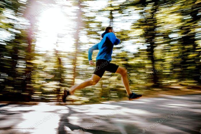 blurred motion male athlete runner