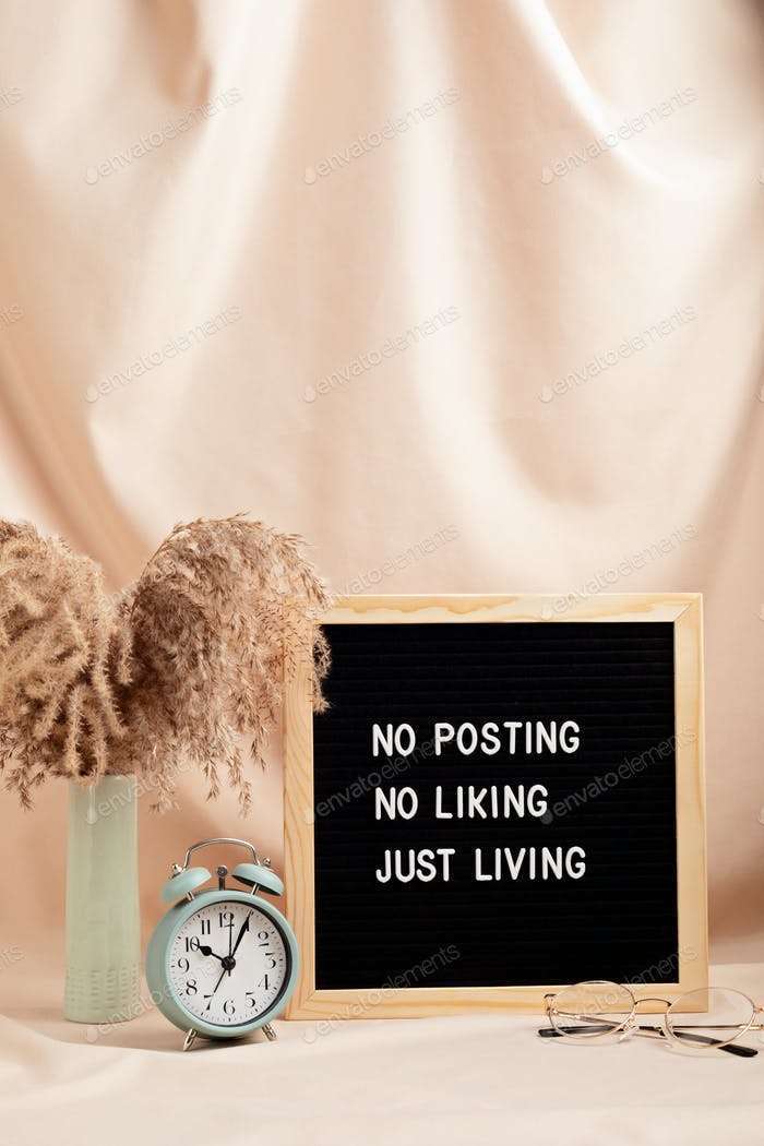 No posting, no liking, just living motivational quote on letter board