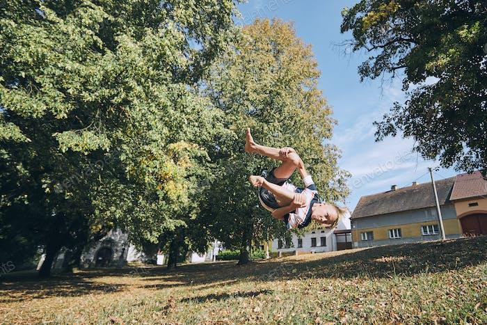 Boy practicing free runnuing