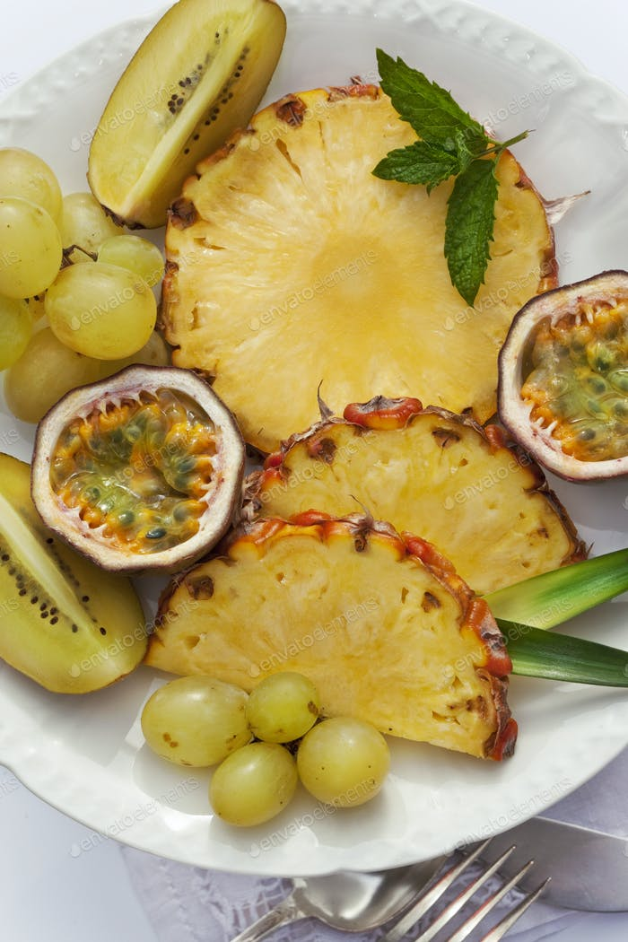 Fresh and appetizing exotic fruits on a plate